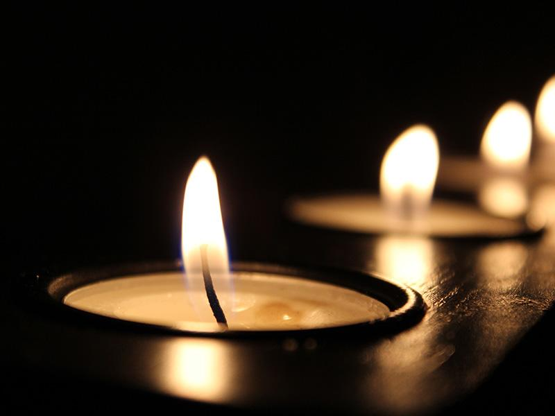 Lit candles on a dark background