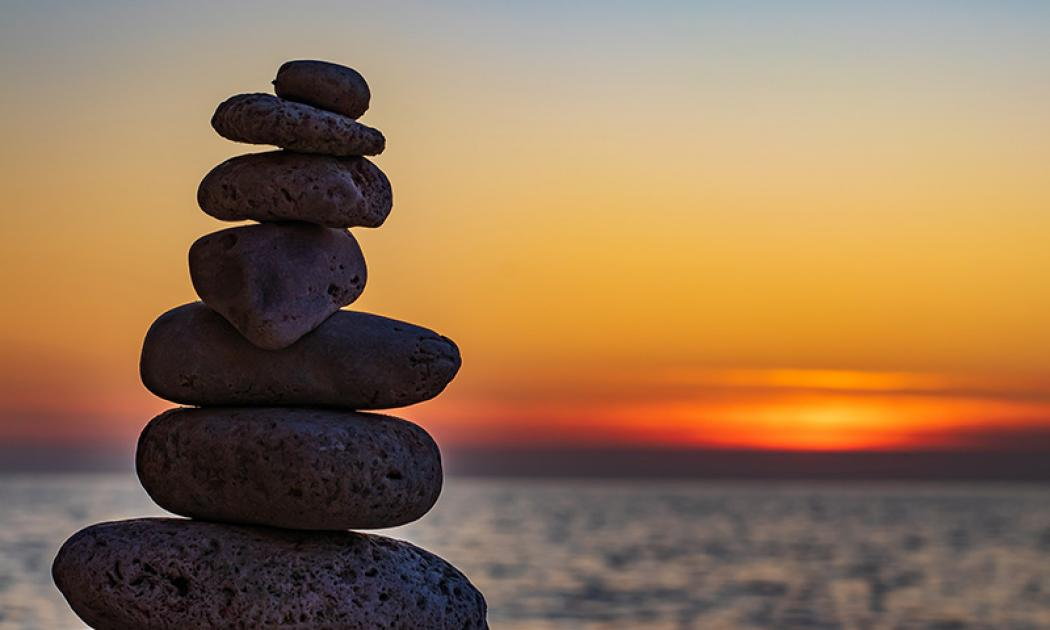 A cairn with sunset in the background