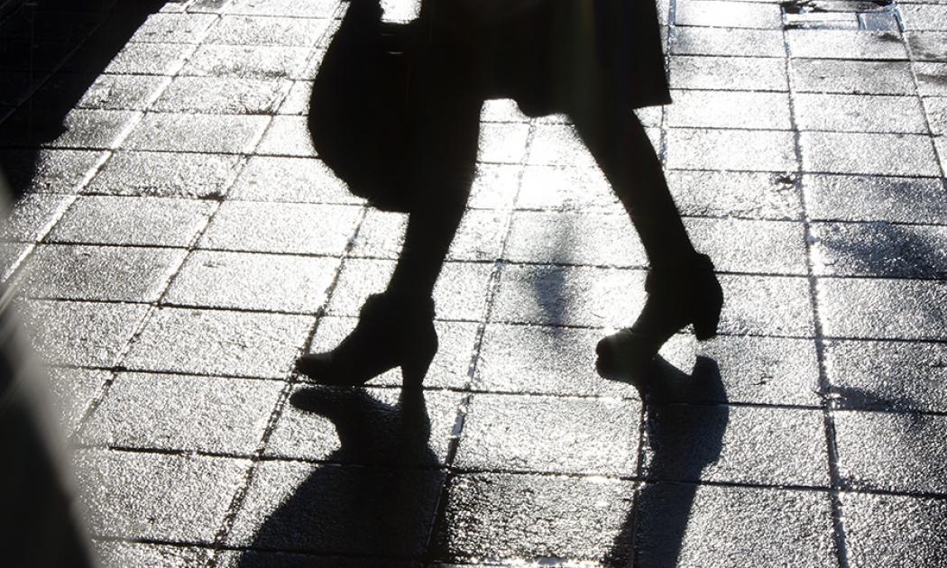 Legs of young woman walking