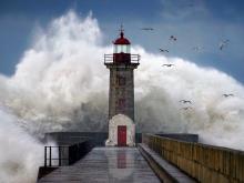 Lighthouse with massive wave crashing into it