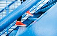 Person Wearing Red Shoes Walking Up Flight Of Stairs