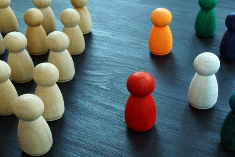 Wood colored game pieces on one side, different color game pieces on the other side